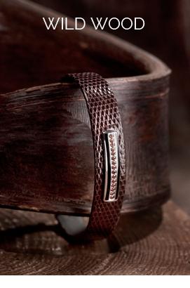 bracelet en lézard brillant marron chaud, barette en or gris brillant, email noir, diamants cognacs